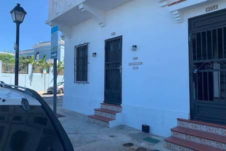 This shows the entrance door and sidewalk area in front of condo entrance