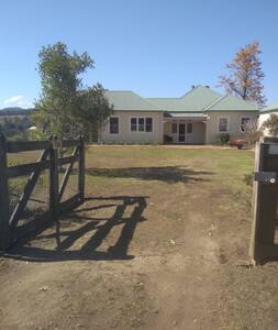 Electric gate to enter property. Level entrance to house. Can drive to door.