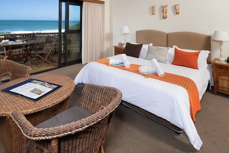Room 8 at African Perfection 1 is a B&B suite with prime location and teh best views!  This room has an en-suite bathroom, tea/coffe station, fully stocked mini bar and snack selection.  Can be set-up with a kingsize bed or two singles.