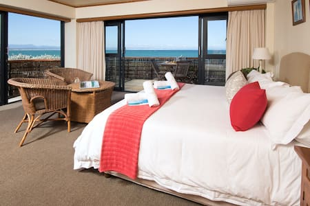 Room 7 - First Floor Sea View Suite with king size bed can also be set up as two single beds.  With the best views of Supertubes, sunrises, sunsets and dolphins swimming by, you wouldn't want to stay anywhere else.