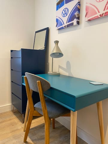 Desk in childrens bedroom.  Ideal for working on, with a lamp with built in wireless charging.
