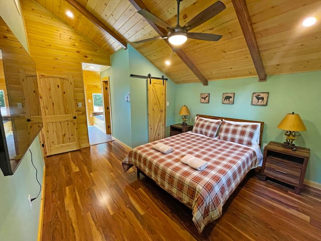 """Fully renovated (2021)  master bedroom suite with queen size bed, 55"""" Roku QLED TV and Fujitu minisplit air conditioner / heating unit for optimal comfort and enjoyment."""