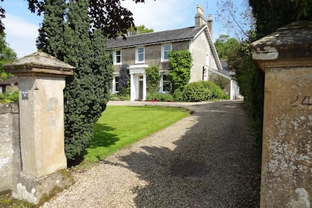There is a level gravel driveway from the road to the front door of the Coach House.  The driveway continues around to the right of the Main House to the back, where the Coach House is situated.