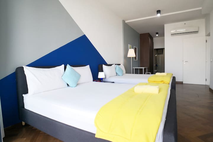 Master bedroom with 2 queen size beds, ensuite bathroom and private seaview balcony.
