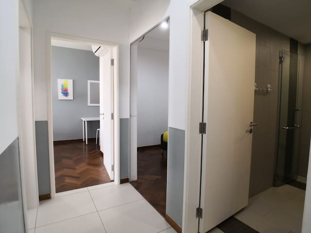hallway of the 3 bedrooms and common bathroom at living room.