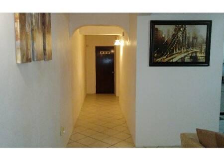 Hallway to bedroom and bathroom.