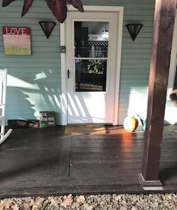 Front porch entrance, one small step up.