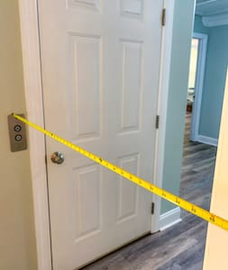 """Very wide hallways throughout house. The hallway pictured here (just outside elevator door) is 46""""."""