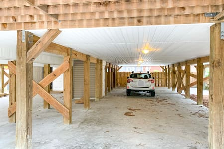 Overhead lighting over covered driveway. Driveway & Elevator access are well-lit.