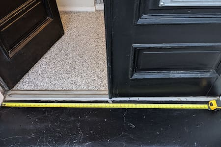"""Use of single door is 28"""" wide.  Use of both doors is ~56"""" wide.  Note - Single step required to access front door, and single step required upon entry to main floor."""