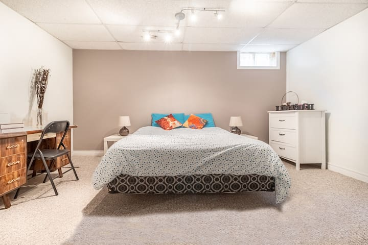 4th room with queen bed.