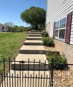 To access our space you must descend cement stairs down to the back basement patio.   There are solar-charging lights along the path at night to light the path. There is no railing, so balance is a must to access our space.  Motion lights are present