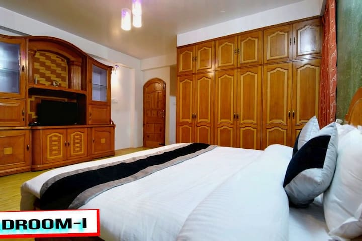 This is room number 101, with a wide entrance and lots of cupboard space to keep your travel stuff.