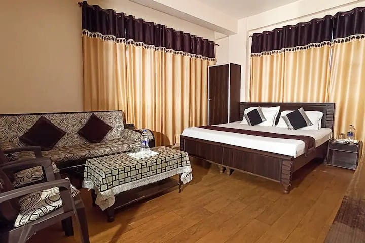 This is room number 104. It has a 02-bedroom interconnected attached bathroom, Sitting area, Kitchen, and a balcony with an amazing valley view.