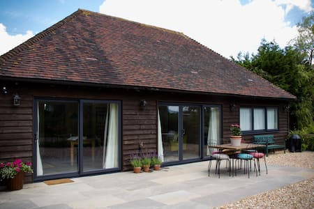 There is a level patio which makes transfer from car to the inside of the barn very easy.  We also have wide sliding doors.