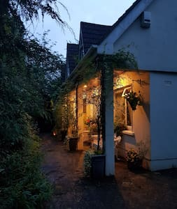 the outdoor lighting  includes a highly effective motion sensor and down lighters give light to the pathway to the front door.  There are also bright Lamps either side of the door.