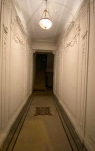 Entrance with strong automatic light along whole way to elevator.