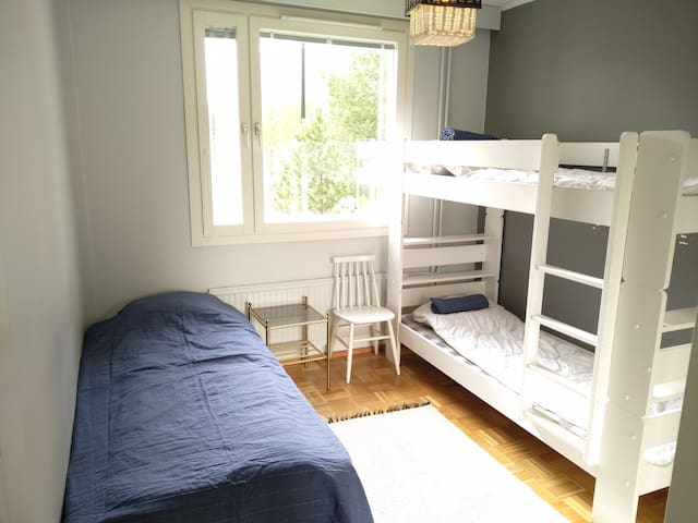 Three beds in one room, and a huge mirror closet facing to the window