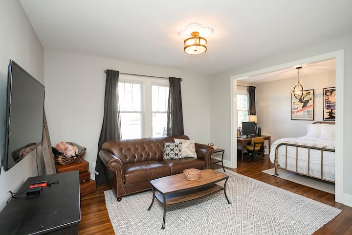 Main level bonus room with full bed, couch, TV, workspace with monitor and internet!