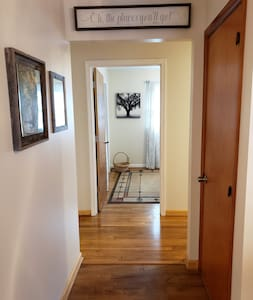 """Wide hall into main hall with 36"""" doorway into wheelchair accessible bedroom."""