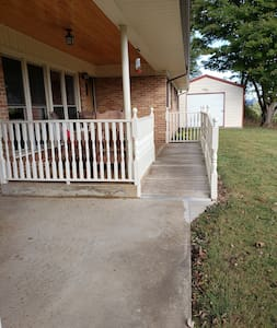 Ramp from covered carport to entrance.
