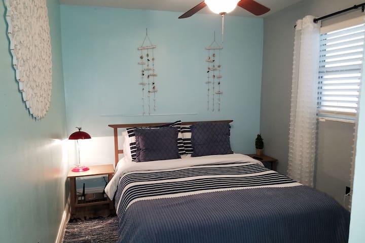 Second Bedroom: Queen size bed, dresser, Smart TV w/ Netflix.
