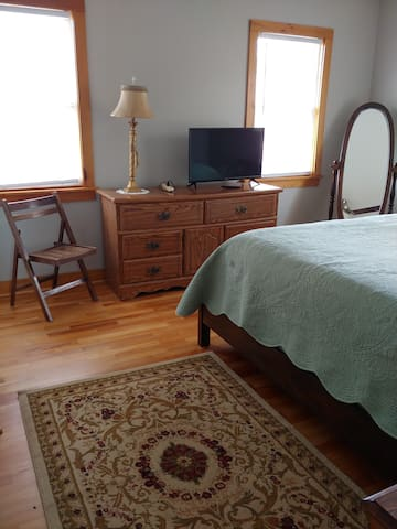 Master Bedroom with lg. closet, full length mirror, two luggage racks for suitcases. Queen size bed with extra blankets in the closet. Private bath with over sized shower rain show. A selections of Body washers, shampoos and cream rinse provided..