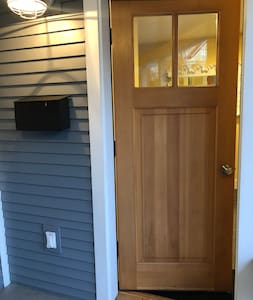 Extra wide entry door from expansive covered entry porch