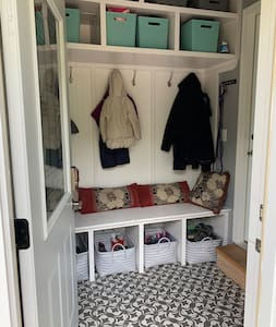 This is the mud room, you can sit and take off your shoes. Hang your bag and coat. Their is a light. It's one step and into the kitchen you enter