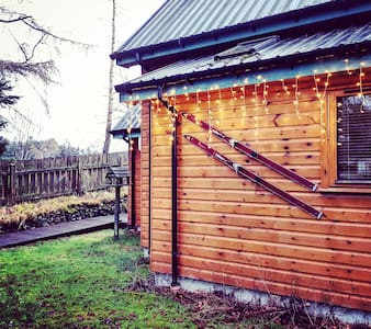 There is a sensor light by the door and path, plus twinkly lights that up all year round.