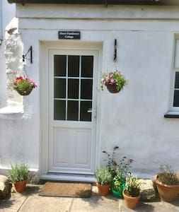 There is a small step to access the cottage