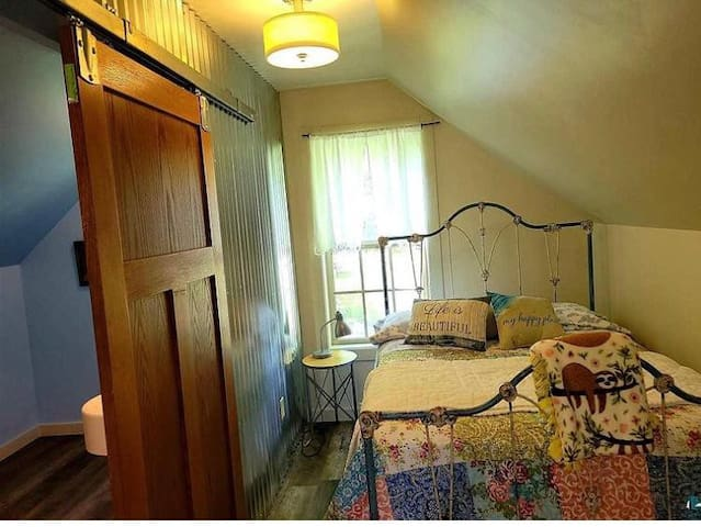 This sweet little 2nd bedroom has a full size bed and 3/4 bathroom.