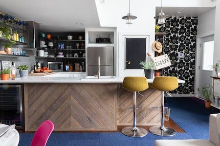 View of Elevator door leading into kitchen and open floor plan living room