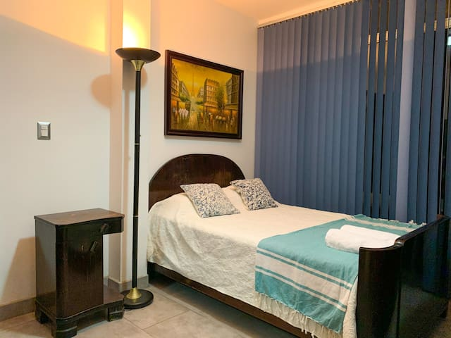 Bed room number 4. Located at the first floor. Full bed with antique furniture. At the first floor there is a full bathroom