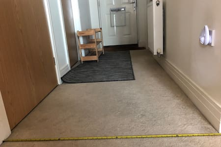 44 inch wide hallway and shoe rack that can be moved to increase accessibility