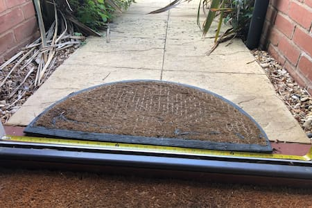 Front door threshold showing 32 inch gap at narrowest point and no step into house