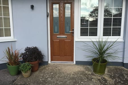 Parking outside front door. No Steps at entrance as you can see slighty raised concrete. Then all on flat when you get inside straight into Lounge. Sensor light at Front Door and Key Safe.