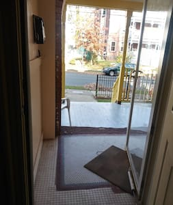 This is the entrance to my house. Enter the front porch, ring the doorbell at 13 or enter using the key pad.