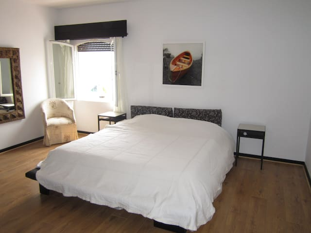 The master bedroom with a double bed