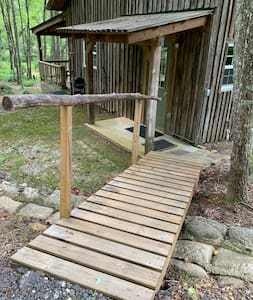 Ramp from parking pad into main cabin entrance.