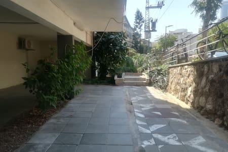 The way to enter the building from the street.