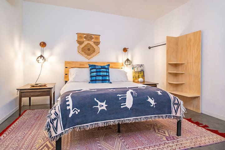 Mid century modern lights and night stands provide the chic simplicity and thoughtful touches which our guests have come to expect.