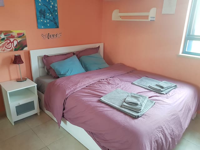 Bedroom with Queen size bed and full bathroom.