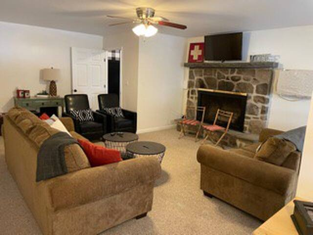 Come relax in the living room with recliners, a queen pull out sofa & brand new smart tv.   *Fireplace is decorative only*