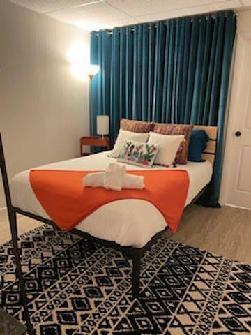 Bedroom 2 Full bed, closet and corner mirror. Door leads to master bathroom.