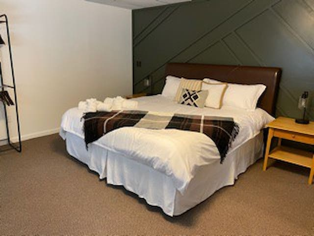 Master bedroom complete with a King bed, dresser, closet and tv/dvd player, a/c, fan and en suite full bath.