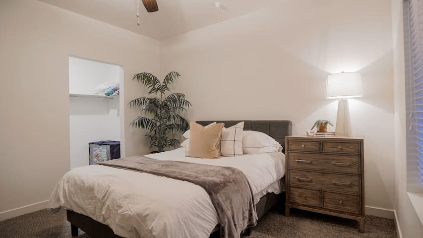 Queen size memory foam bed. Our guests continue to compliment the comfort of this great bed.  There is a very large walk-in closet as shown here as well. This is where the extra fold out mats, bedding, iron and ironing board are stored.