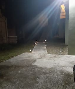 Walk way to apt with sensor light and path light also security camera