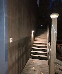 Solar lights on the stairs. There is a light switch at the base of the steps for the stairs also. Please turn the light off once inside. Thanks!