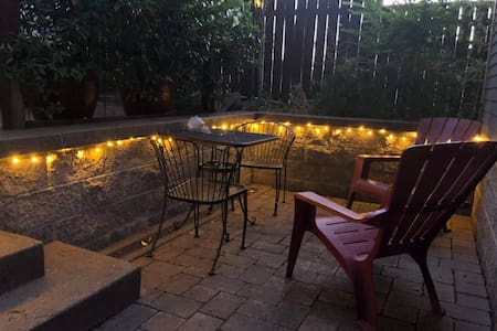 Park in the driveway right next to your own private well-lit patio